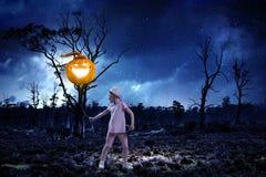 Kid with pumpkin. Mixed media. Small girl holding pumpkin balloon celebrating Halloween. Mixed media royalty free stock images