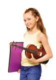 Small girl holding purple folder and violin Stock Image