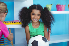Small girl holding a soccer ball Royalty Free Stock Image
