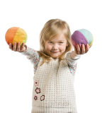 Small girl holding soft multi-colored balls Royalty Free Stock Photography