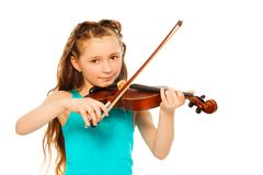 Small girl holding string and playing on violin Royalty Free Stock Photography