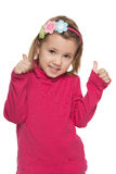Small girl holds his thumbs up stock images