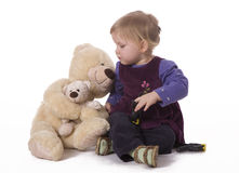Small girl hugging big teddy bear Royalty Free Stock Image