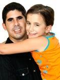 Small girl hugging a young latin man Stock Photo