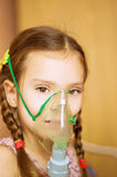 Small girl with inhalator. In hospital royalty free stock photo