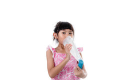 Small girl inhaling medicine Royalty Free Stock Images