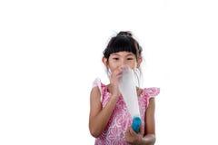 Small girl inhaling medicine Royalty Free Stock Photo