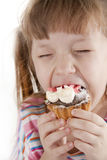 Small Girl Is Eating Cake Royalty Free Stock Photo