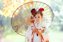 Small girl in kimono with umbrella Royalty Free Stock Photo