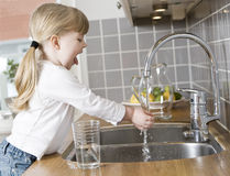Small Girl in the kitchen Royalty Free Stock Photo