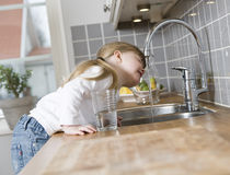 Small Girl in the kitchen Stock Images