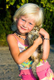 Small girl with kitten Royalty Free Stock Photography