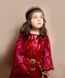 Small girl. Kurdish girl in red classic kurdish dress in Iraq Royalty Free Stock Photo