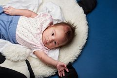 Small girl laying on pillow stock photography