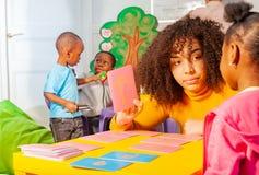 Small girl learn cursive alphabet, nursery school royalty free stock photo