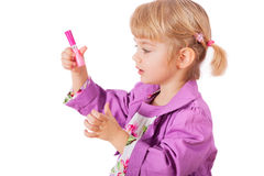 Small girl with lipstick Stock Image