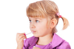 Small girl with lipstick isolated on white Stock Photography