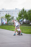 Small girl looking back when riding bike Stock Images