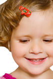 Small girl looking down. Small beautiful girl looking down and smiling Royalty Free Stock Photography