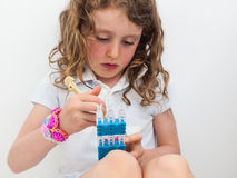 Small girl  loom banding Stock Photos
