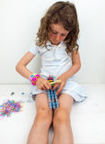 Small girl  loom banding Royalty Free Stock Image