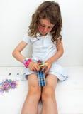 Small girl loom banding royalty free stock image