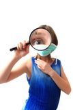 Small girl and magnify glass Royalty Free Stock Images