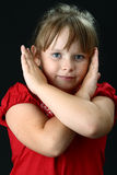 Small girl making X sign with her arms on black Royalty Free Stock Image