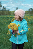 Small girl  on meadow Royalty Free Stock Images