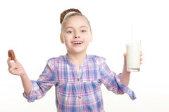 Small girl with milk and cookie Stock Image