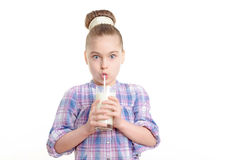 Small girl with milk and cookie Royalty Free Stock Image