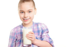 Small girl with milk and cookie Royalty Free Stock Photos