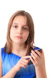 Small girl and mobile phone. Isolated on the white background Stock Photo