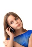 Small girl and mobile phone. Isolated on the white background Royalty Free Stock Image