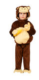 Small girl with monkey suit and banana Royalty Free Stock Photography