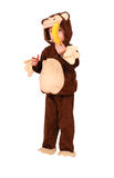 Small girl with monkey suit and banana Stock Photos