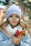 Small girl outdoor portrait.Child in autumn park with berries in Stock Image