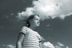 Small girl over sky Stock Photos