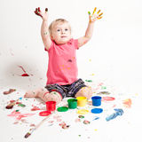Small girl with paint Stock Images
