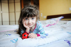 Small girl in pajama Stock Image