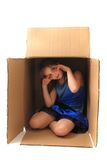 Small girl in the paper box Royalty Free Stock Photos