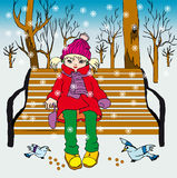 Small girl in park. Little girl in winter clothes feeding birds in park Stock Photo