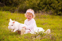 Small girl with pet rabbit Royalty Free Stock Photography