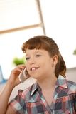 Small girl on phone Royalty Free Stock Images