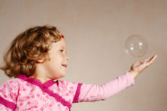 Small girl in pink dress with a bubble Royalty Free Stock Images