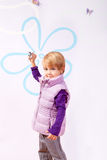 Small girl in pink vest with toy airplane Stock Photography