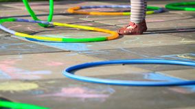 Small girl play hula hoops on playground Royalty Free Stock Photos