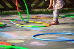 Small girl play hula hoops Royalty Free Stock Image
