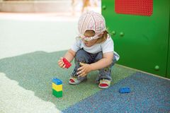 Small girl playing Stock Images