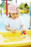Small girl playing Royalty Free Stock Images